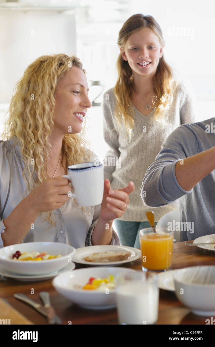 Girl having breakfast with their parents - Stock Image