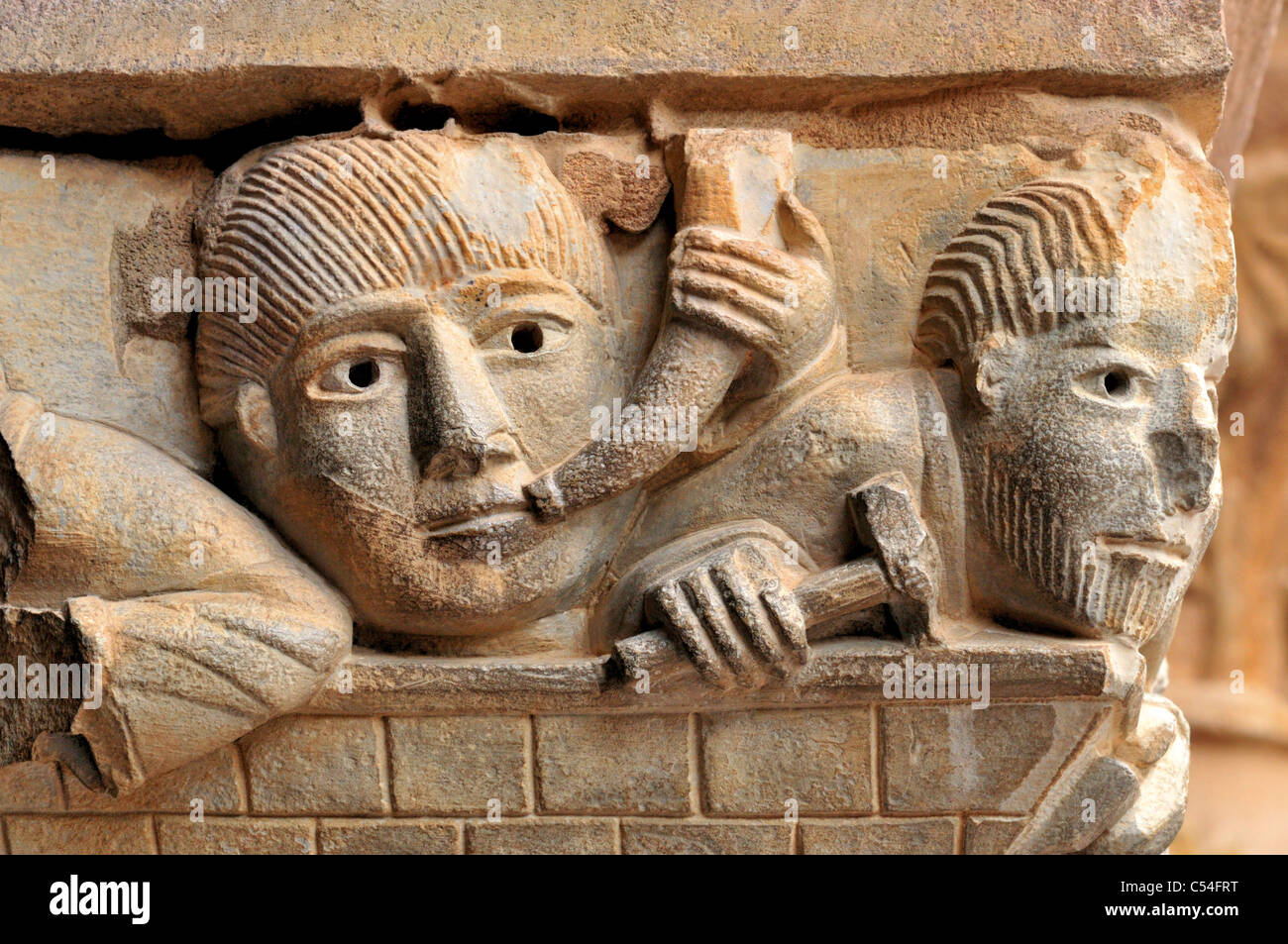 France, St. James Way: Detail of a romanesque capital at the former cloister of Abbey St. Foy in Conques - Stock Image