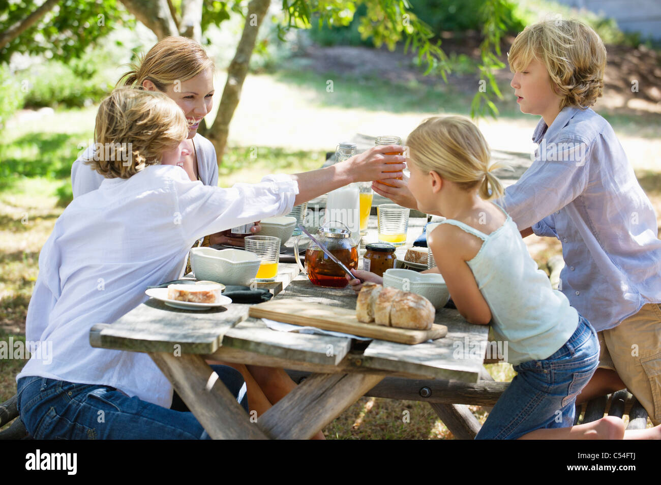 Family having food at front or back yard - Stock Image