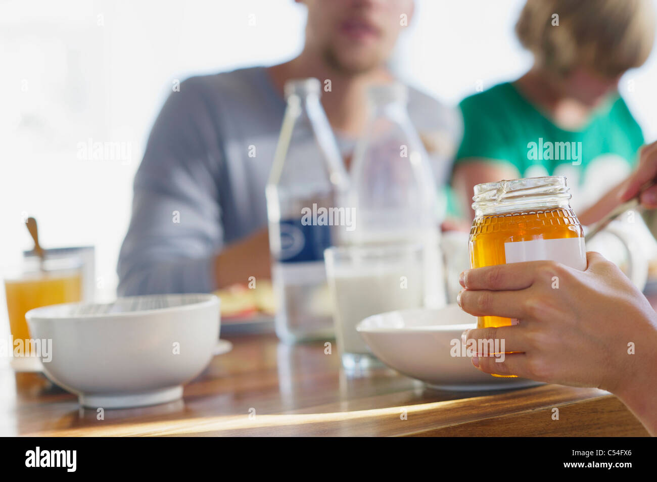 Family having breakfast at a dining table - Stock Image