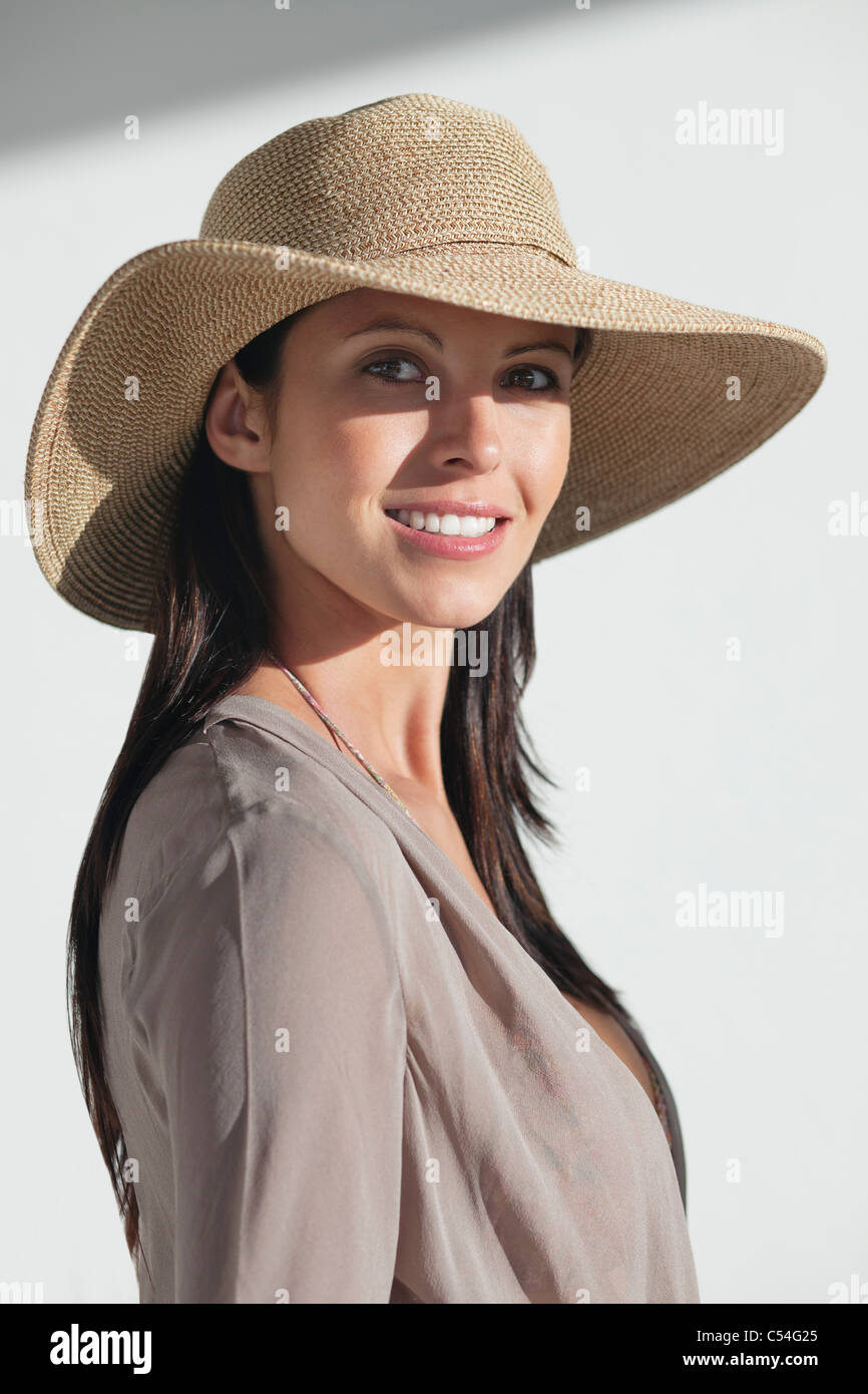 Portrait of a woman wearing sun hat and smiling - Stock Image