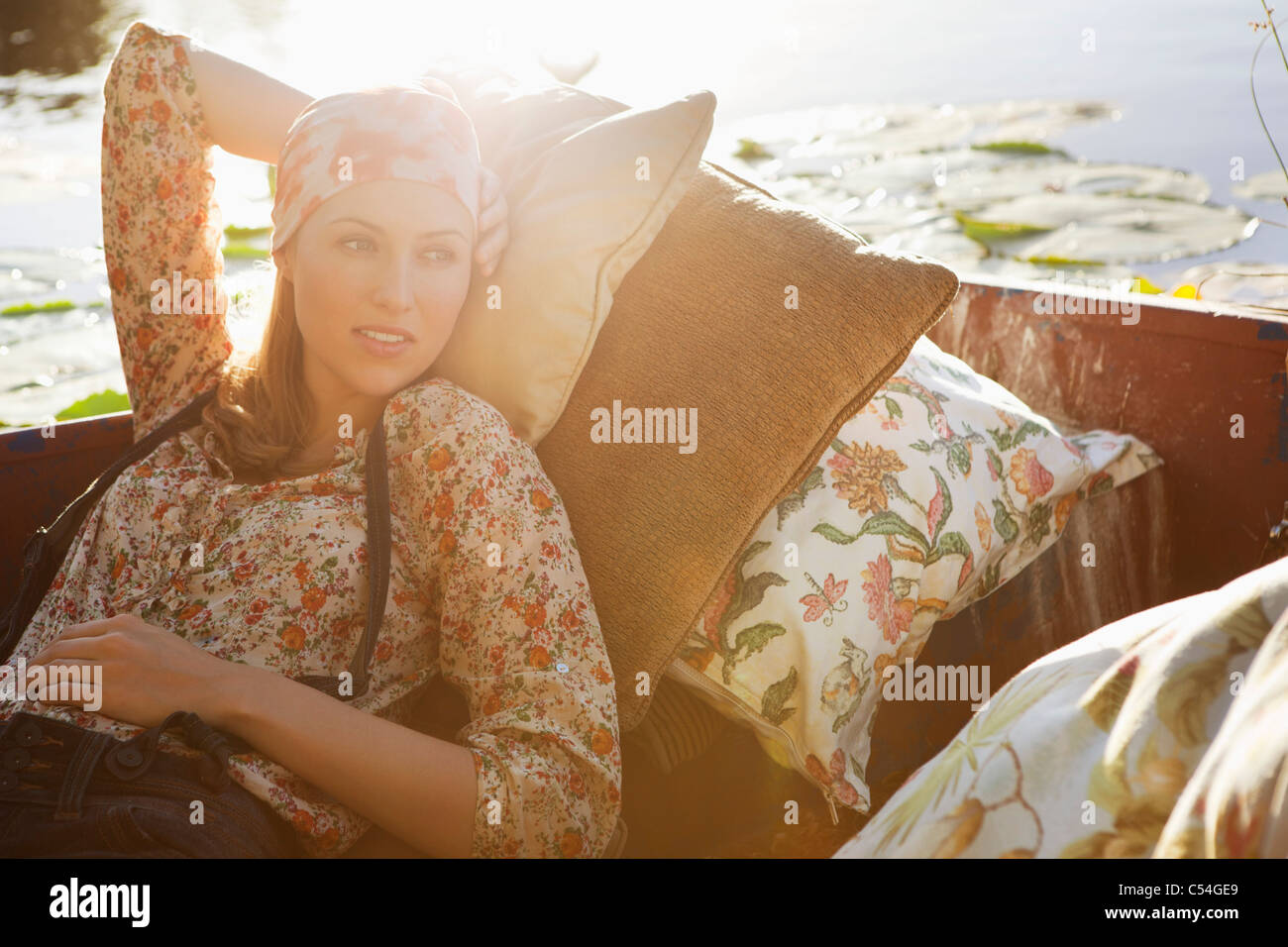 Beautiful woman day dreaming in the boat - Stock Image