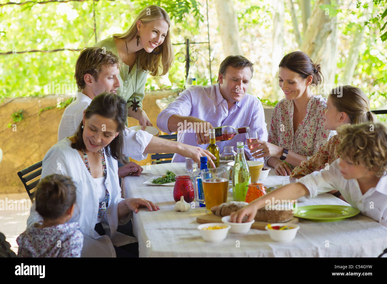 Multi generation family eating food at house - Stock Image