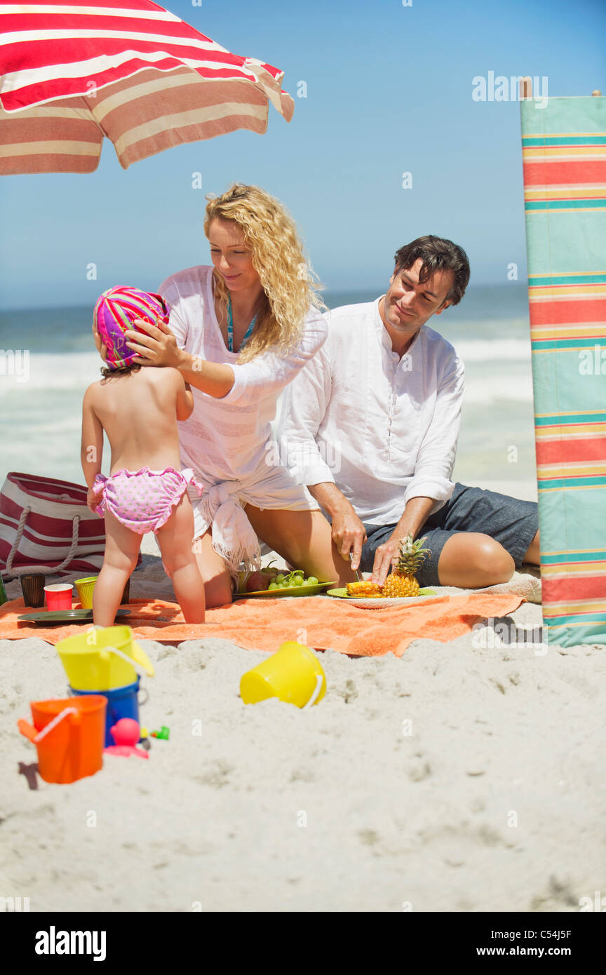 Family having good time on the beach - Stock Image