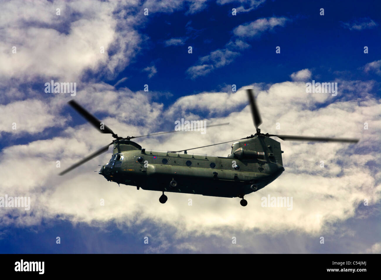 British Army, training, Chinook, Helicopter, Flying, Clouds, Isle of Wight, England, UK - Stock Image