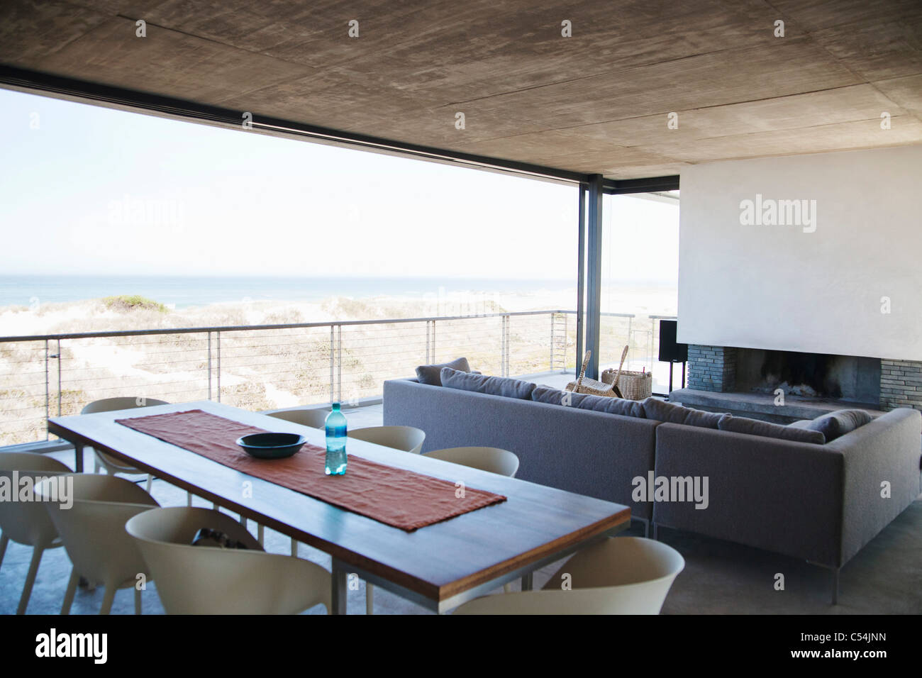 Home interiors with beach in the background - Stock Image