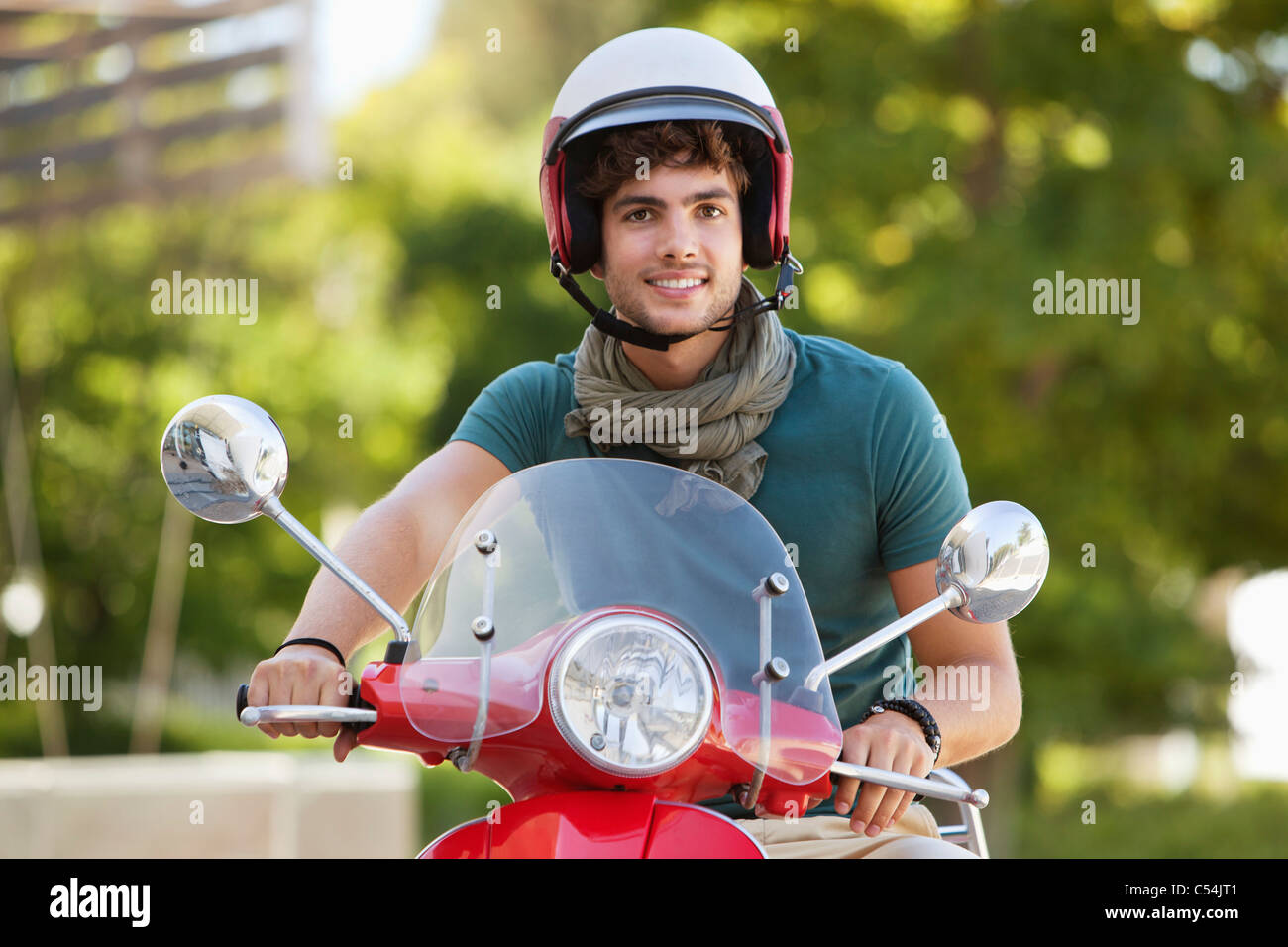 Man riding a scooter - Stock Image