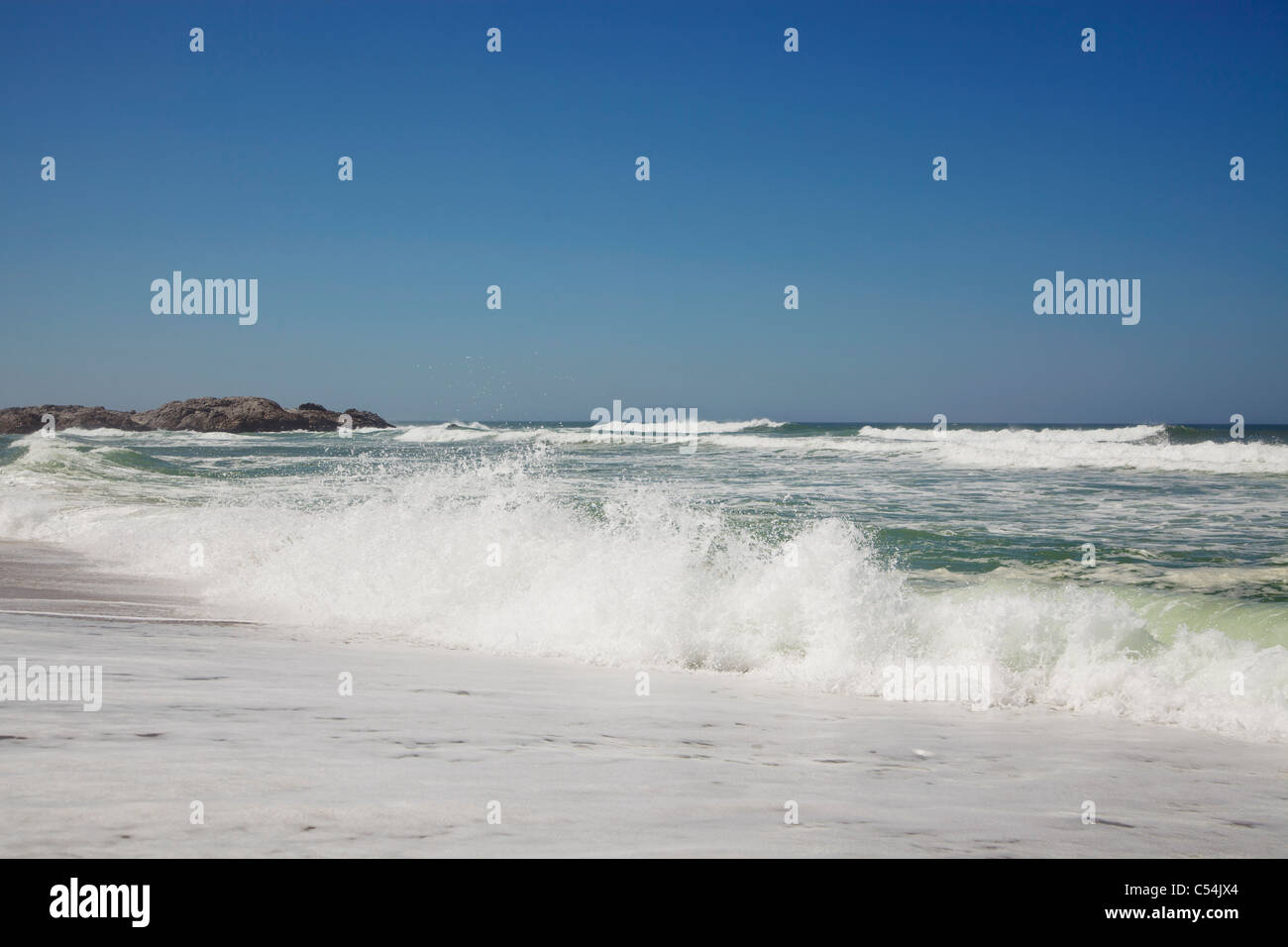 Beautiful view of beach against clear sky - Stock Image