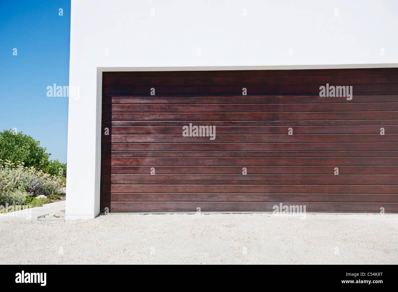 Closed door of a garage - Stock Image