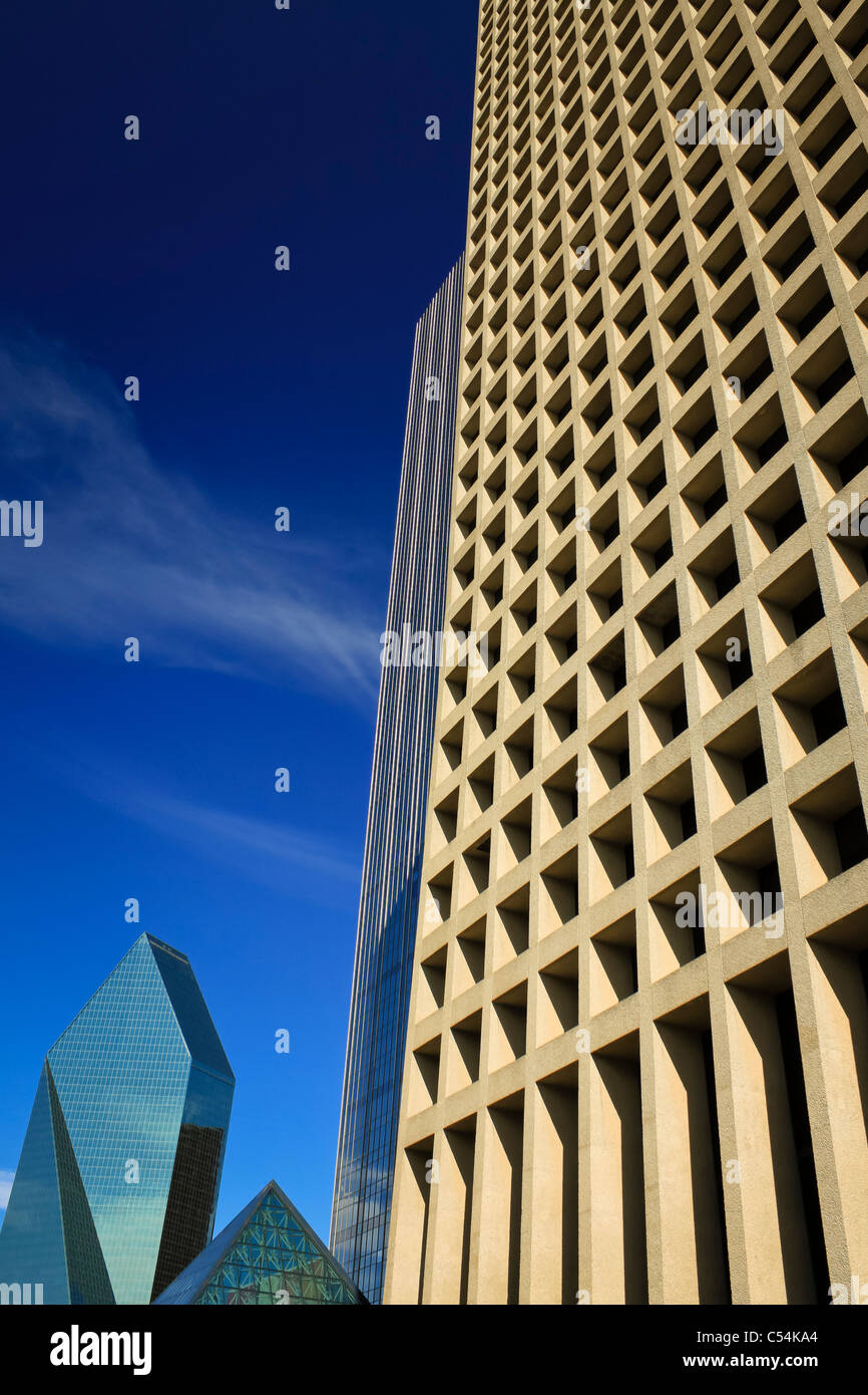0ld-fashioned rectangular office building with repetitive pattern on its facade in sharp contrast with a modern - Stock Image
