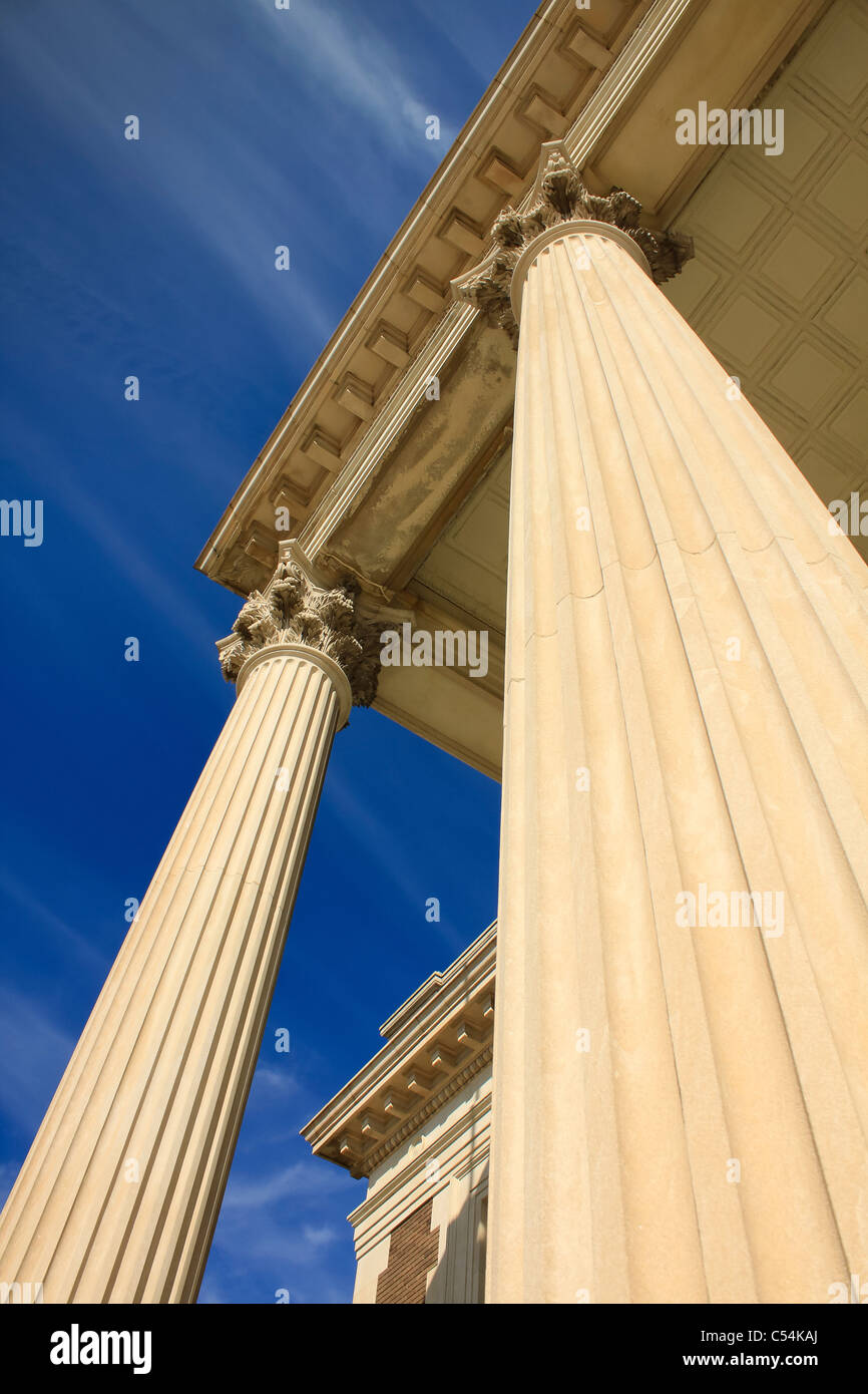 Two Corinthian columns in perspective against blue sky. Stock Photo