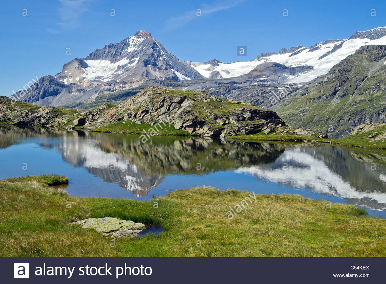 Reflections of the Dent Parrachée in alpine lake of Vanoise mountain range - Maurienne - Savoy (France) - Stock Image