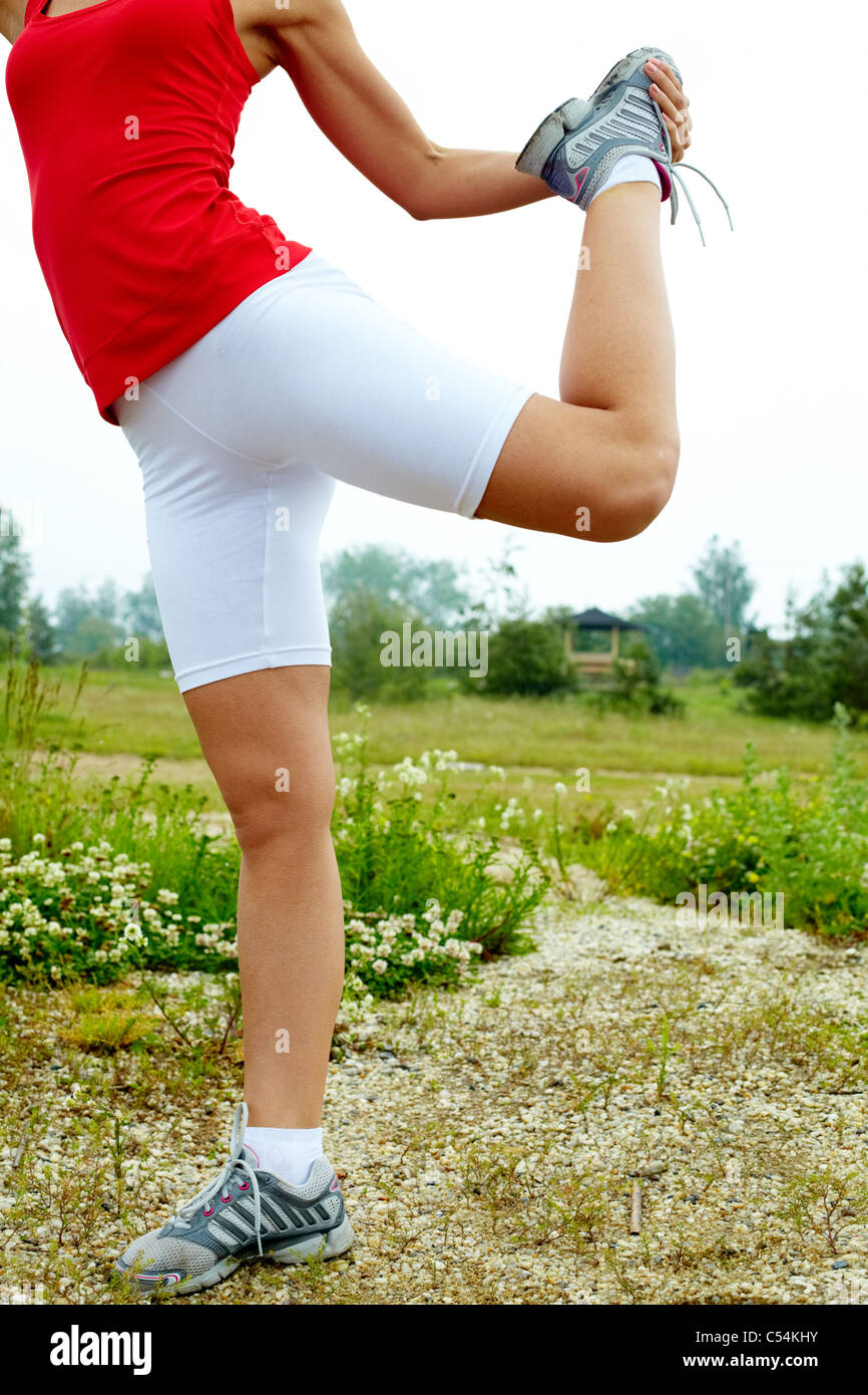 Image of female legs during physical exercise outdoors Stock Photo