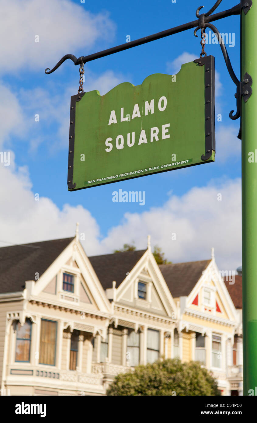 San Francisco  the famous 'Painted Ladies' well maintained old Victorian houses on Alamo Square California - Stock Image