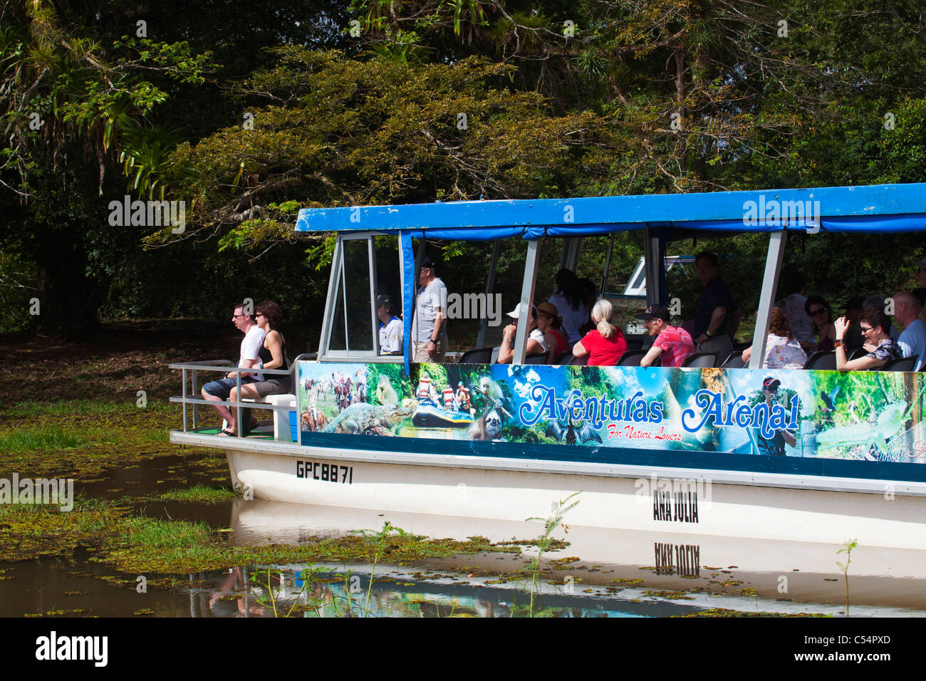 Ecotourism ecotourists 50+ on boat tour in tropical jungle and rainforest Rio Frio Los Chiles - Stock Image