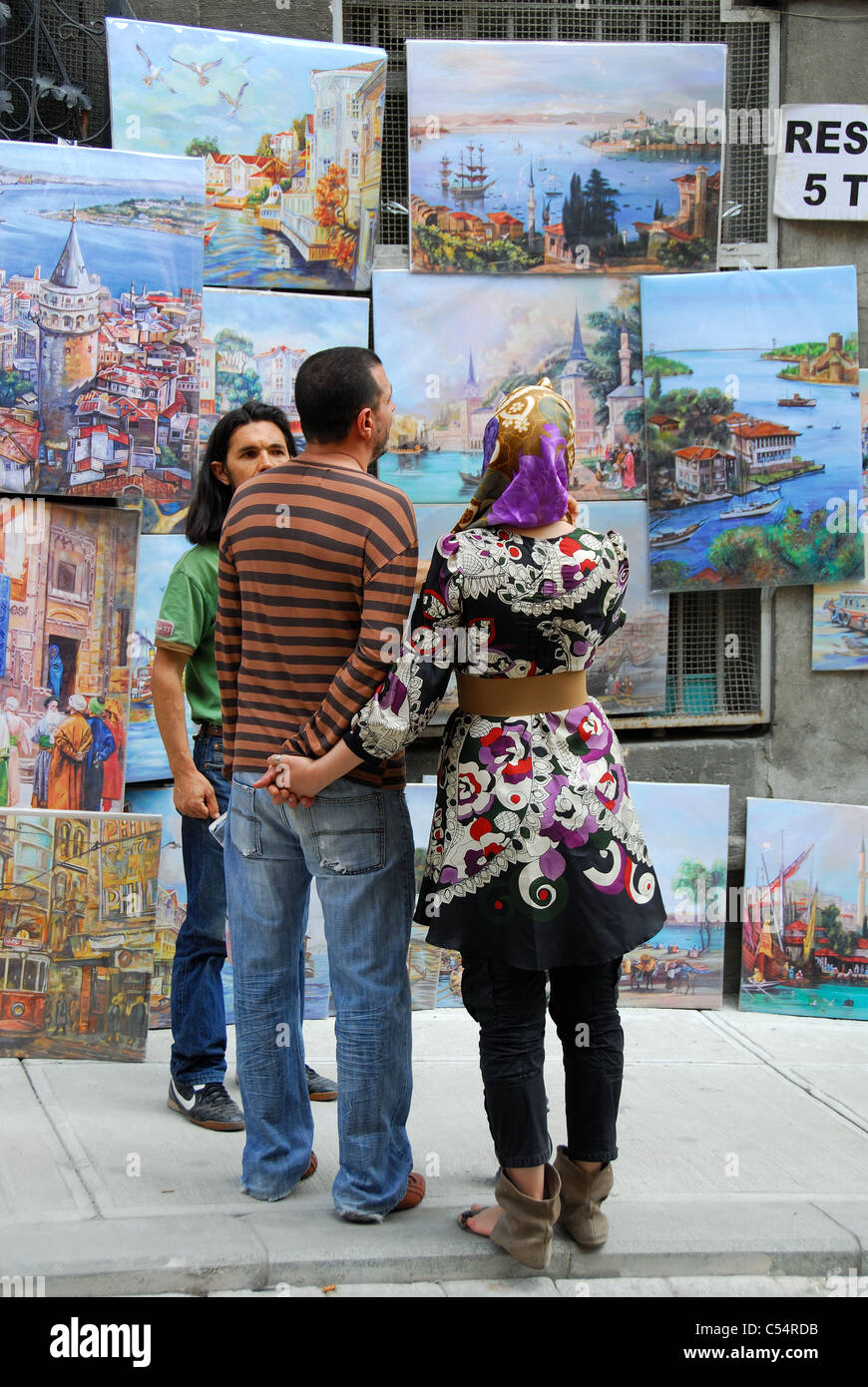 ISTANBUL, TURKEY  A young Turkish couple looking at paintings for