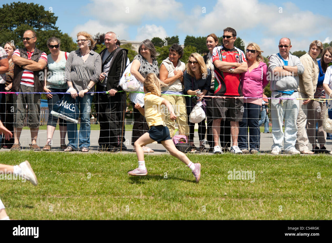 Parents watching their children compete at the annual School sports day at a small primary school, UK - Stock Image