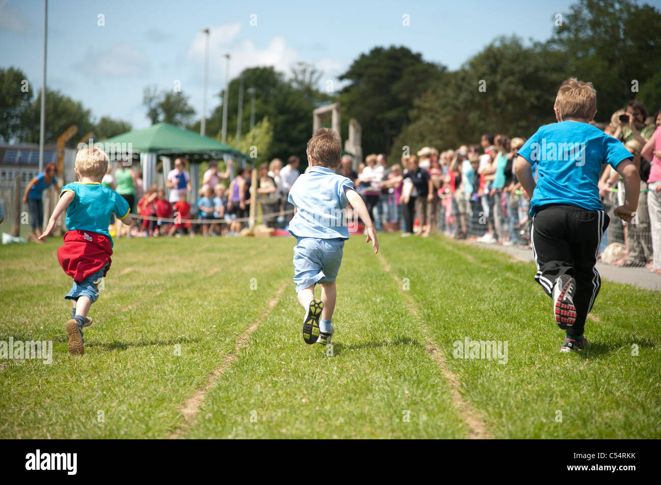 Young small boys racing at the annual School sports day at a small primary school, UK - Stock Image
