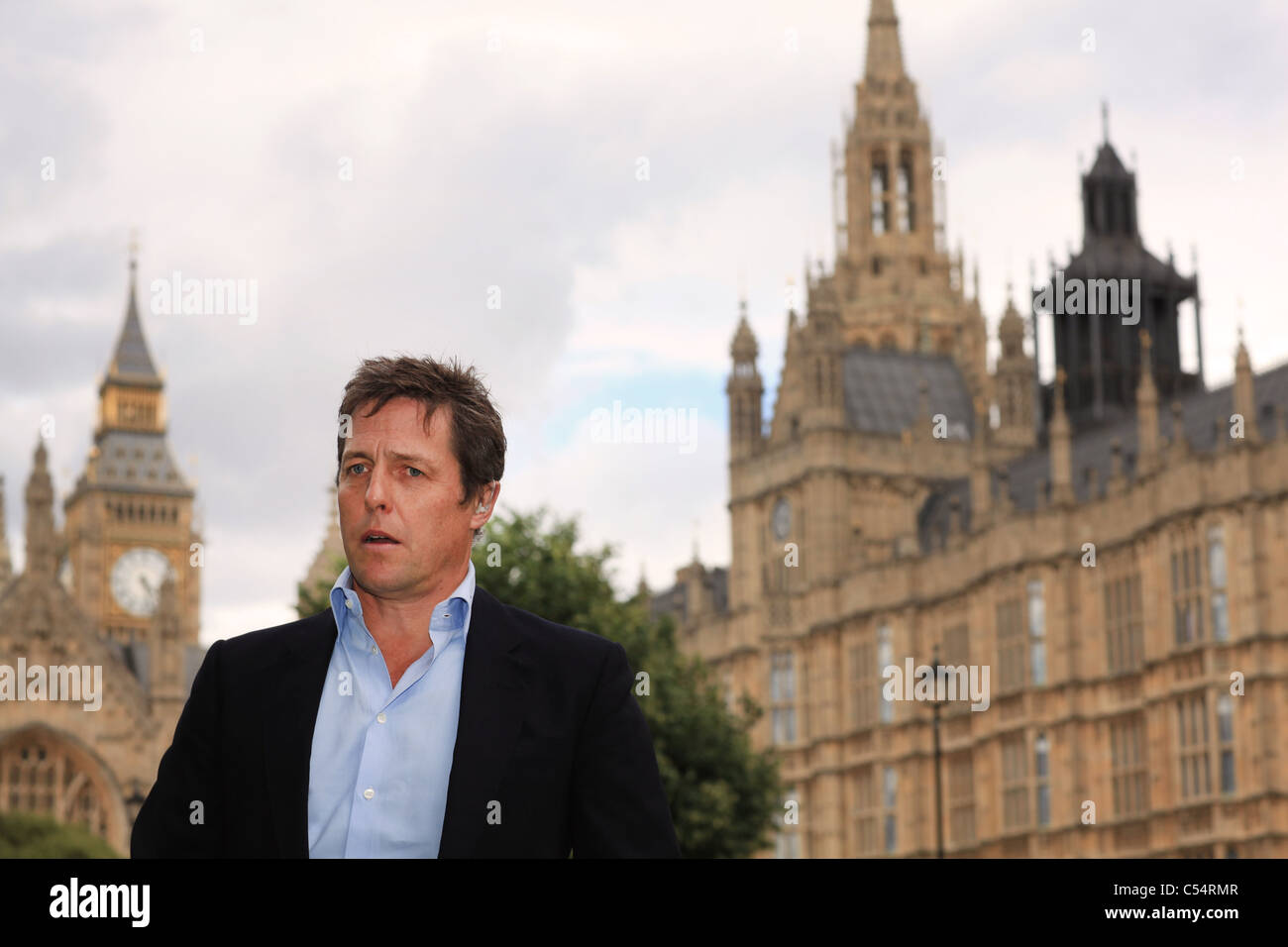 Actor Hugh Grant during a protest against telephone hacking outside the Houses of Parliament in London - Stock Image