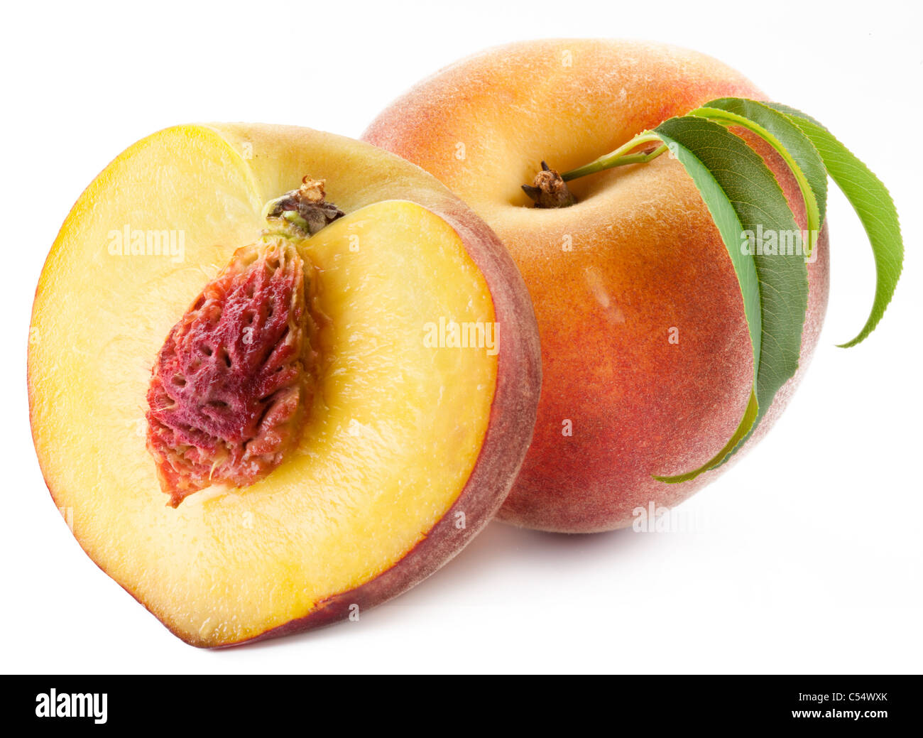 Ripe peach with leaves isolated on a white background. - Stock Image