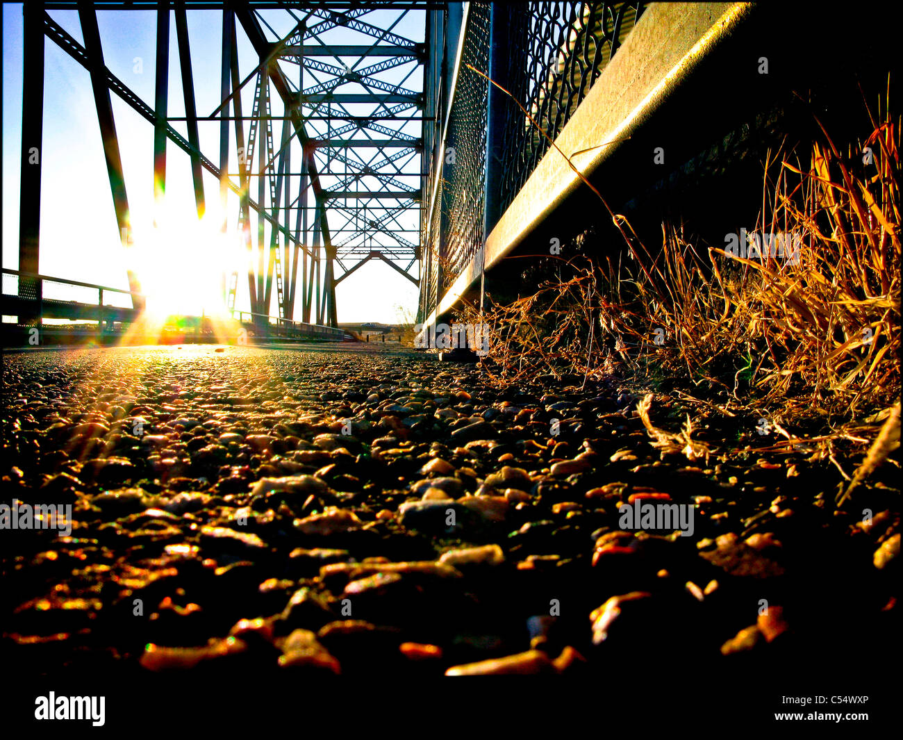 Pedestrian bridge at sunset - Stock Image