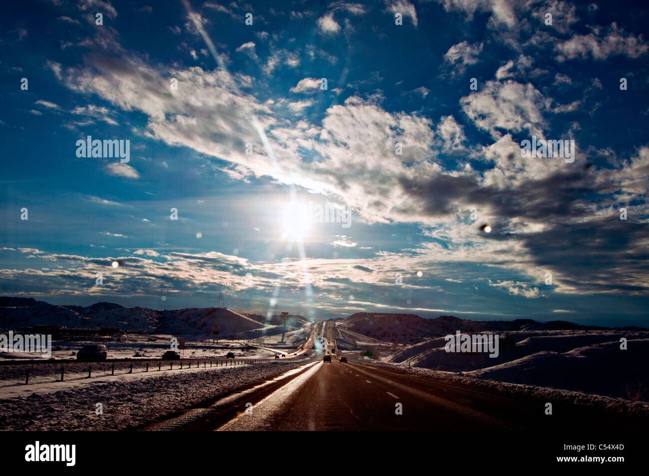 USA, New Mexico, Road going through winter landscape - Stock Image