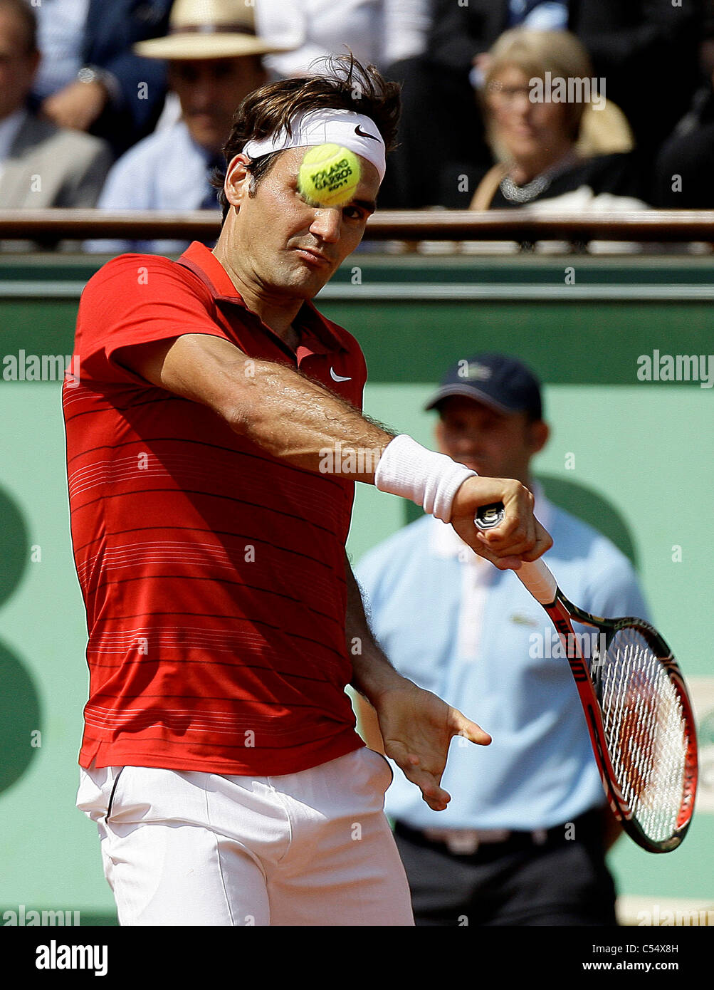 Roger Federer in action against World number one and defending champion Rafael Nadal in the Final of the French Open at Roland G Stock Photo