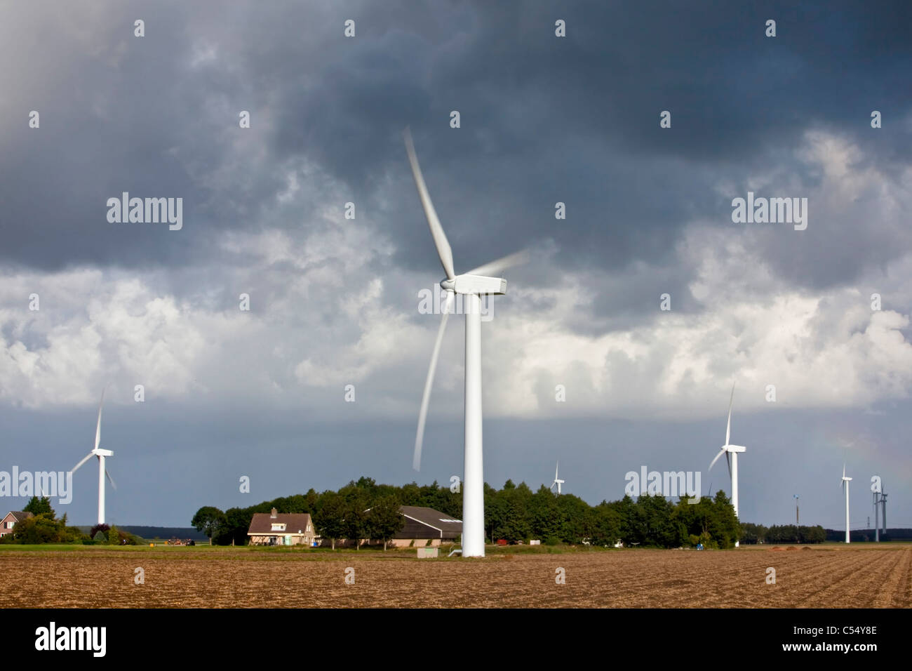The Netherlands, Almere, Wind turbines, windmills and farm - Stock Image