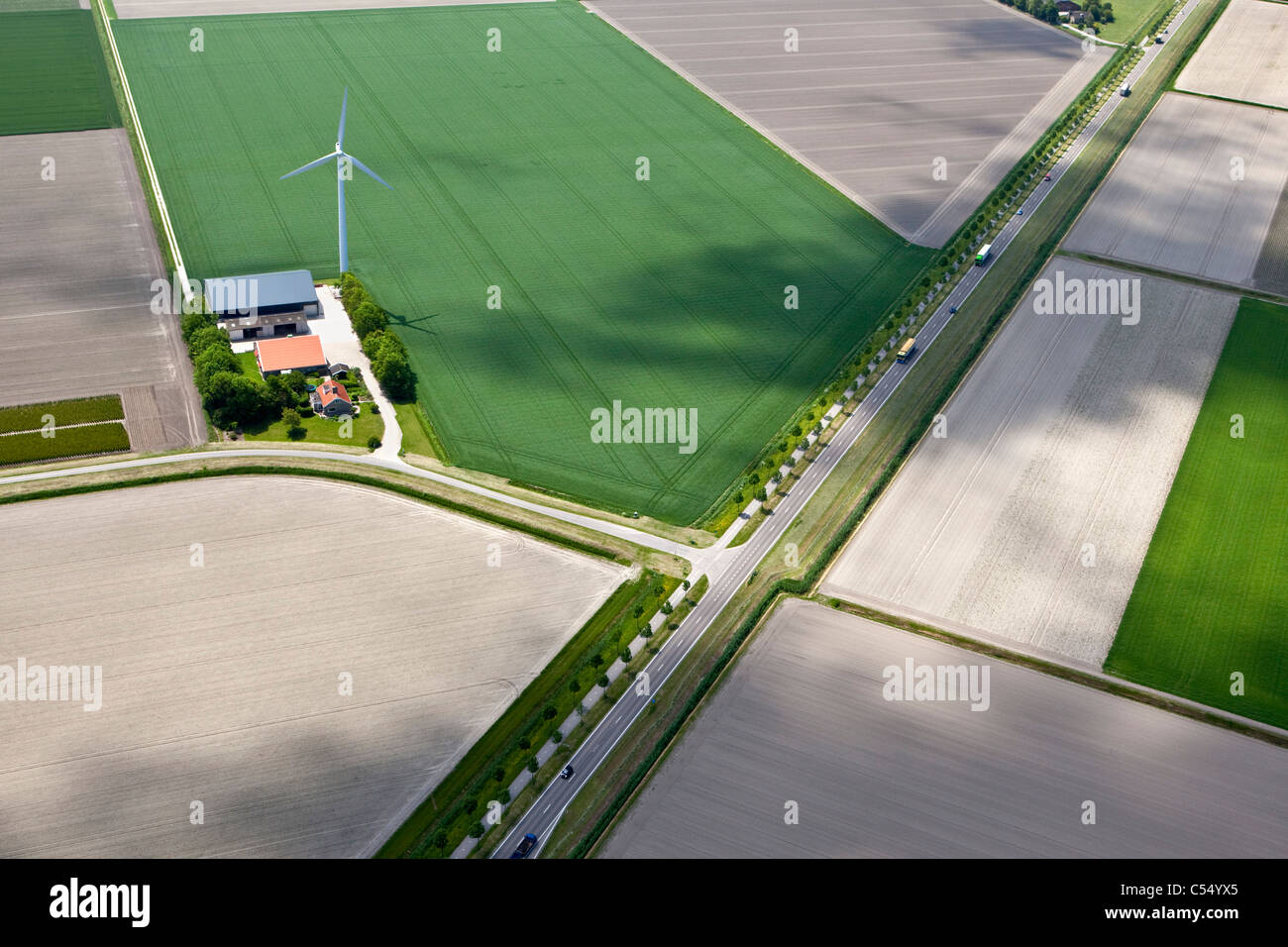 The Netherlands, Ens, Farm and farmland in polder landscape. Aerial - Stock Image