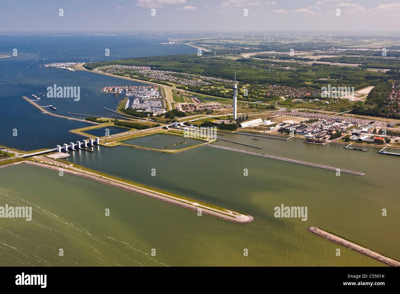 The Netherlands, Lelystad, View on dam, locks, marina, Broadcasting TV tower and Flevopolder. Aerial - Stock Image