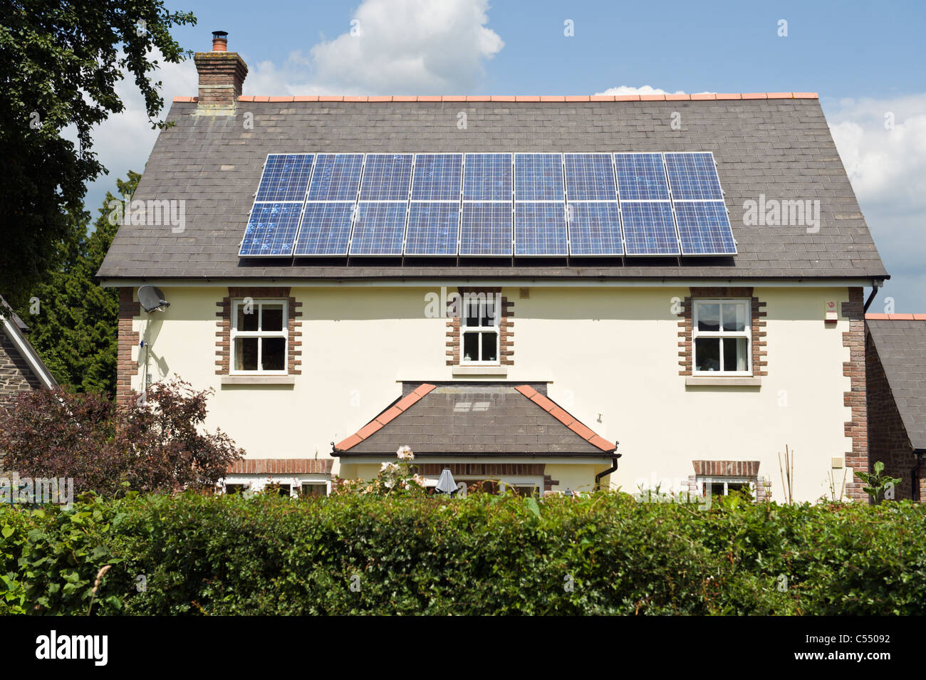 Solar panels on roof of detached house in village of Llangattock Powys South Wales UK - Stock Image