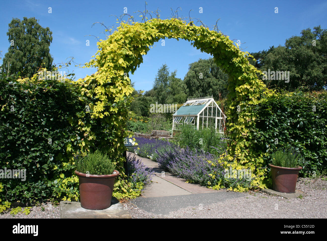 Archway Through To A Secluded Garden - Stock Image