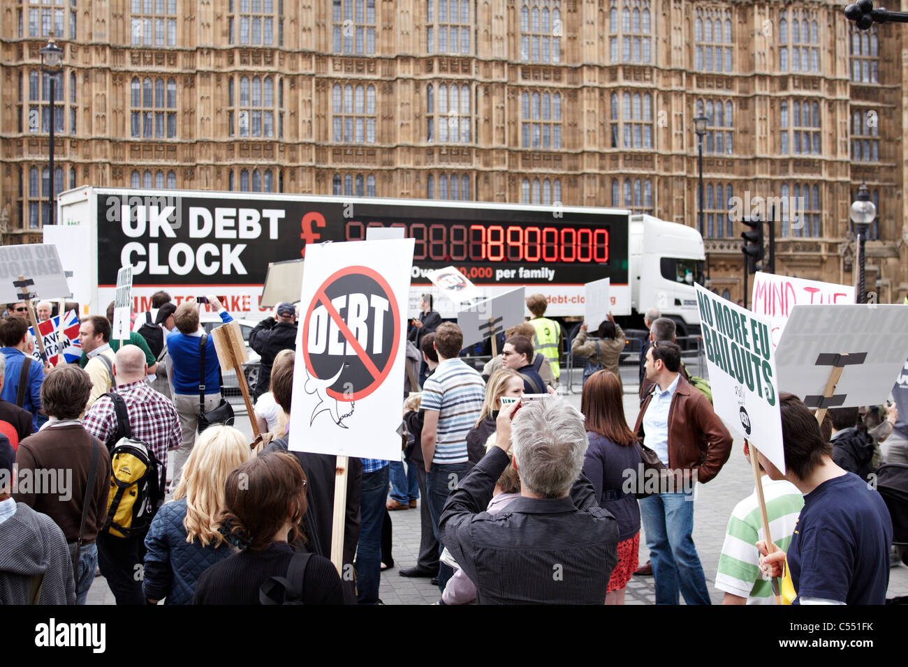 Around 250 people take part in a Rally Against Debt to call for greater public spending cuts to eliminate the UK - Stock Image
