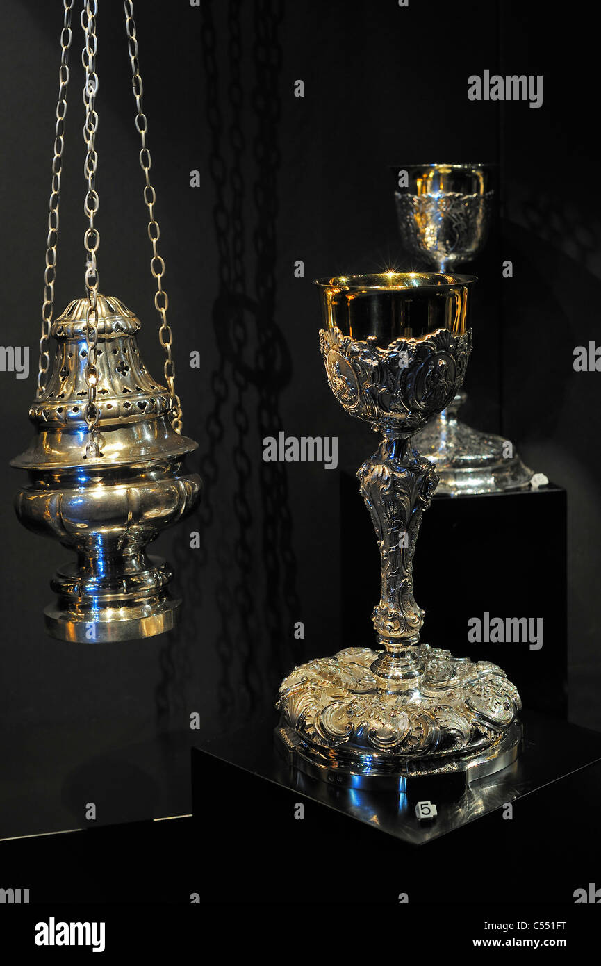 Collection of religious silverware at the Ten Duinen abbey museum at Koksijde, Belgium - Stock Image