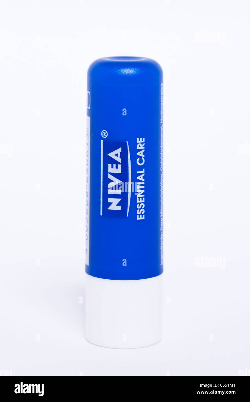A Nivea essential care lipsalve on a white background - Stock Image