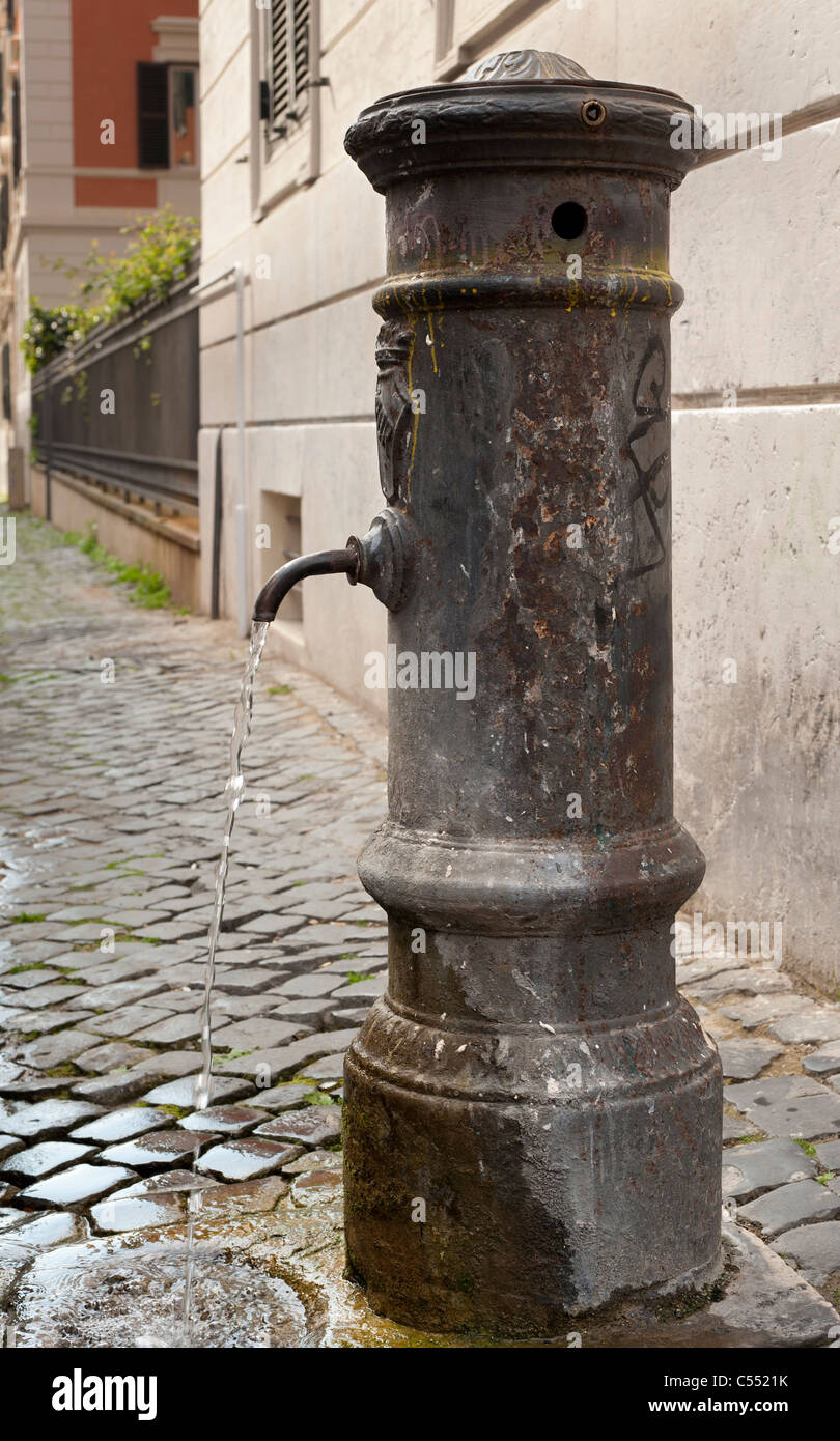 A public water tap in Rome - Stock Image