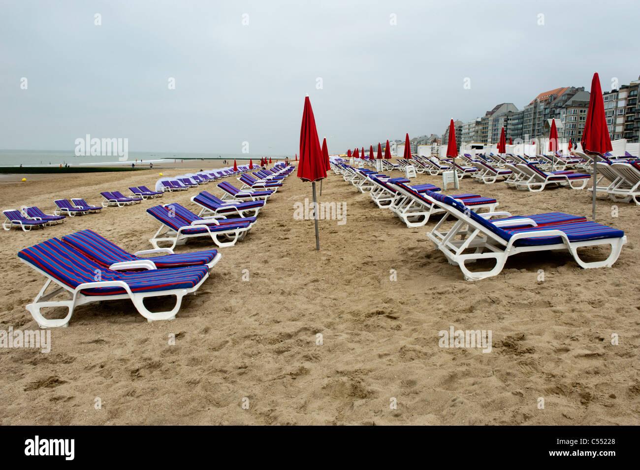 Deckchairs on the beach at the Belgian seaside resort of  Knokke-Heist - Stock Image