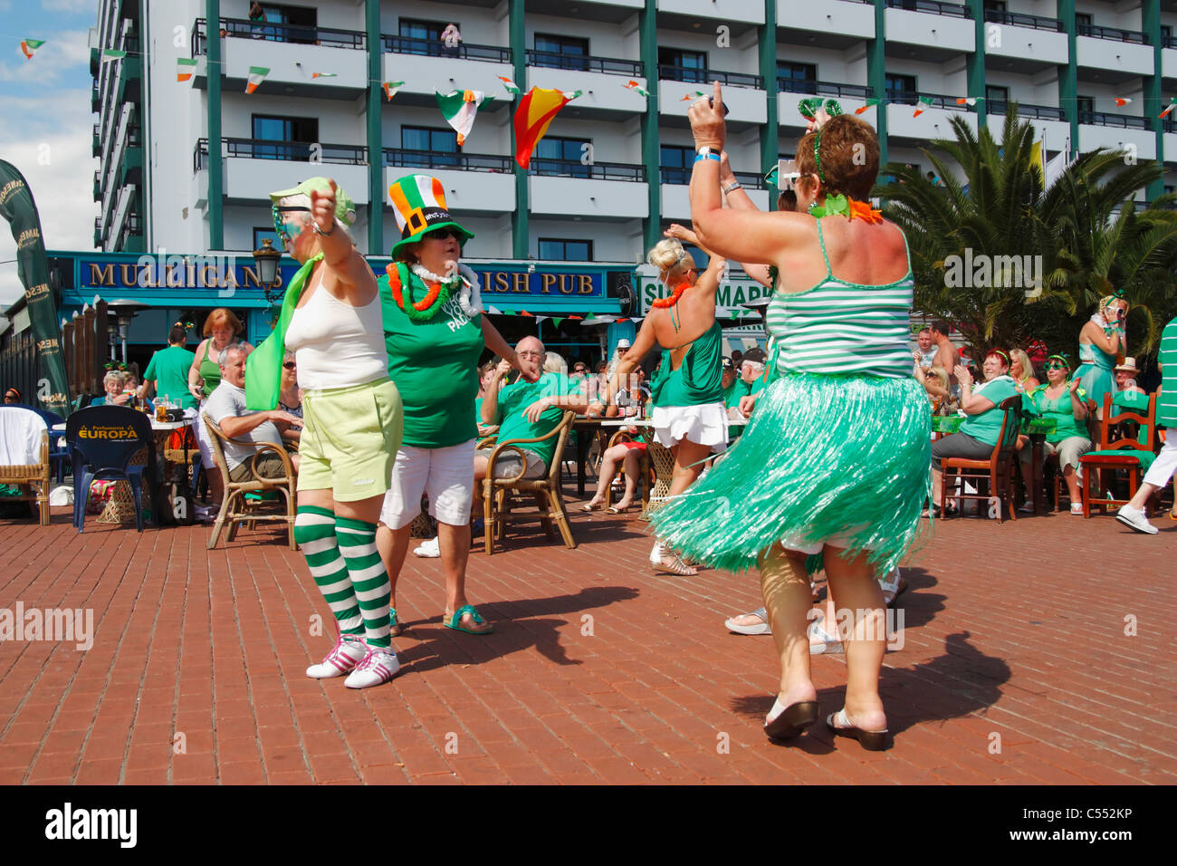Irish holidaymakers Celebrating St Patrick's day outside Irish pub on Gran Canaria in the Canary Islands - Stock Image