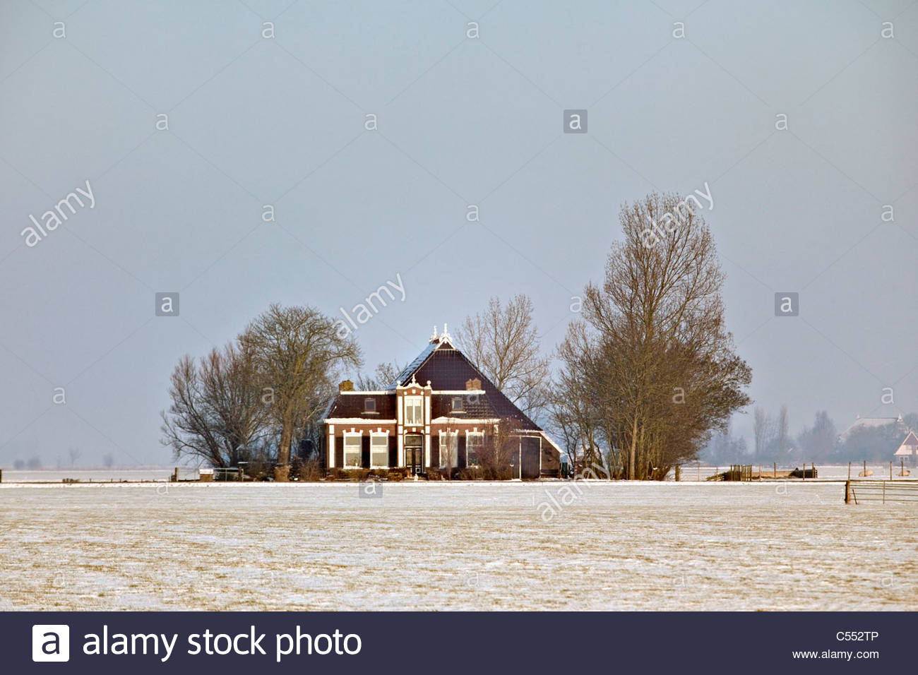 The Netherlands, Wommels, Farm in snow. - Stock Image