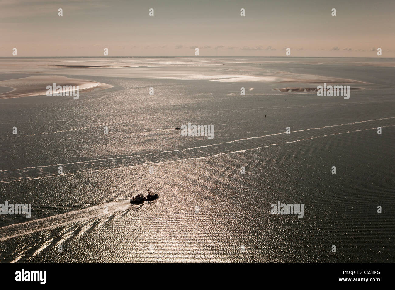The Netherlands,Near Island Terschelling, group of islands called: Wadden in Wadden Sea. Fast ferry boat. Aerial. - Stock Image