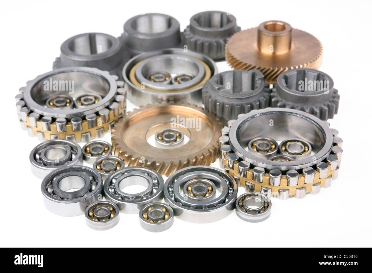 This photo shows the gears and bearings on white background - Stock Image