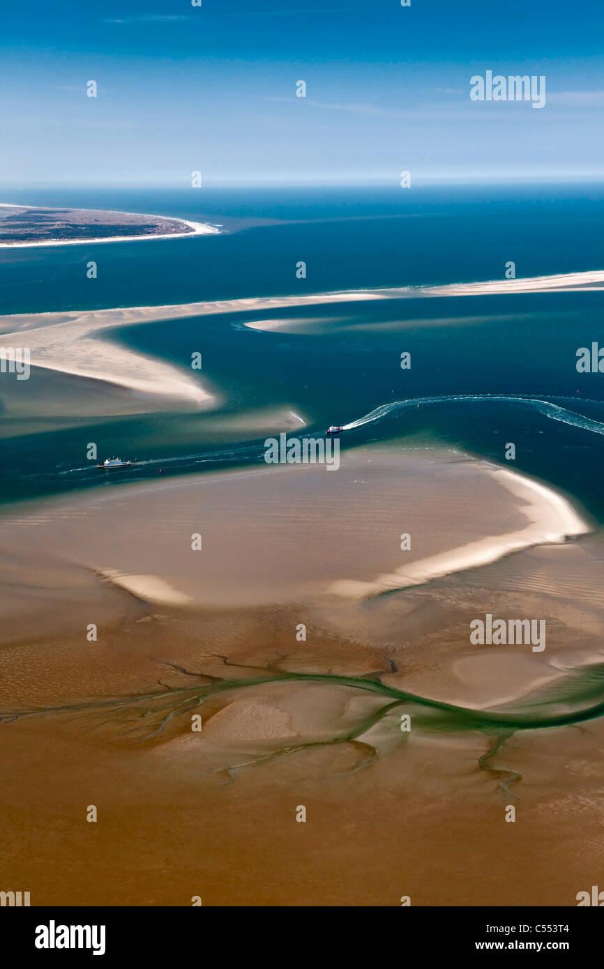 Netherlands, Island Terschelling, group of islands called Wadden Sea. Unesco World Heritage Site. Low tide. Ferryboat. - Stock Image