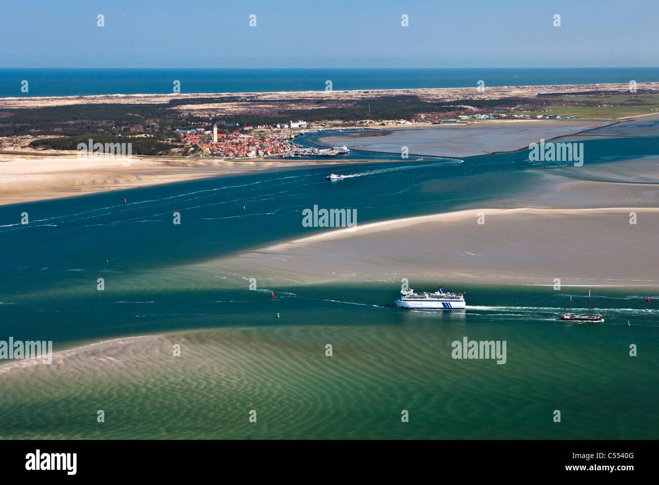 Holland, Island Terschelling, Wadden Sea. Unesco World Heritage Site. Low tide. Ferry Boat, village Terschelling - Stock Image