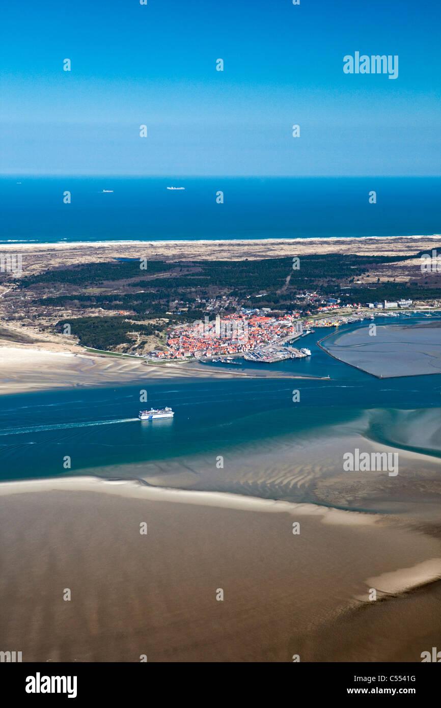 Holland, Island Terschelling, Wadden Sea. Unesco World Heritage Site. Low tide. Ferry Boat. Village Terschelling - Stock Image