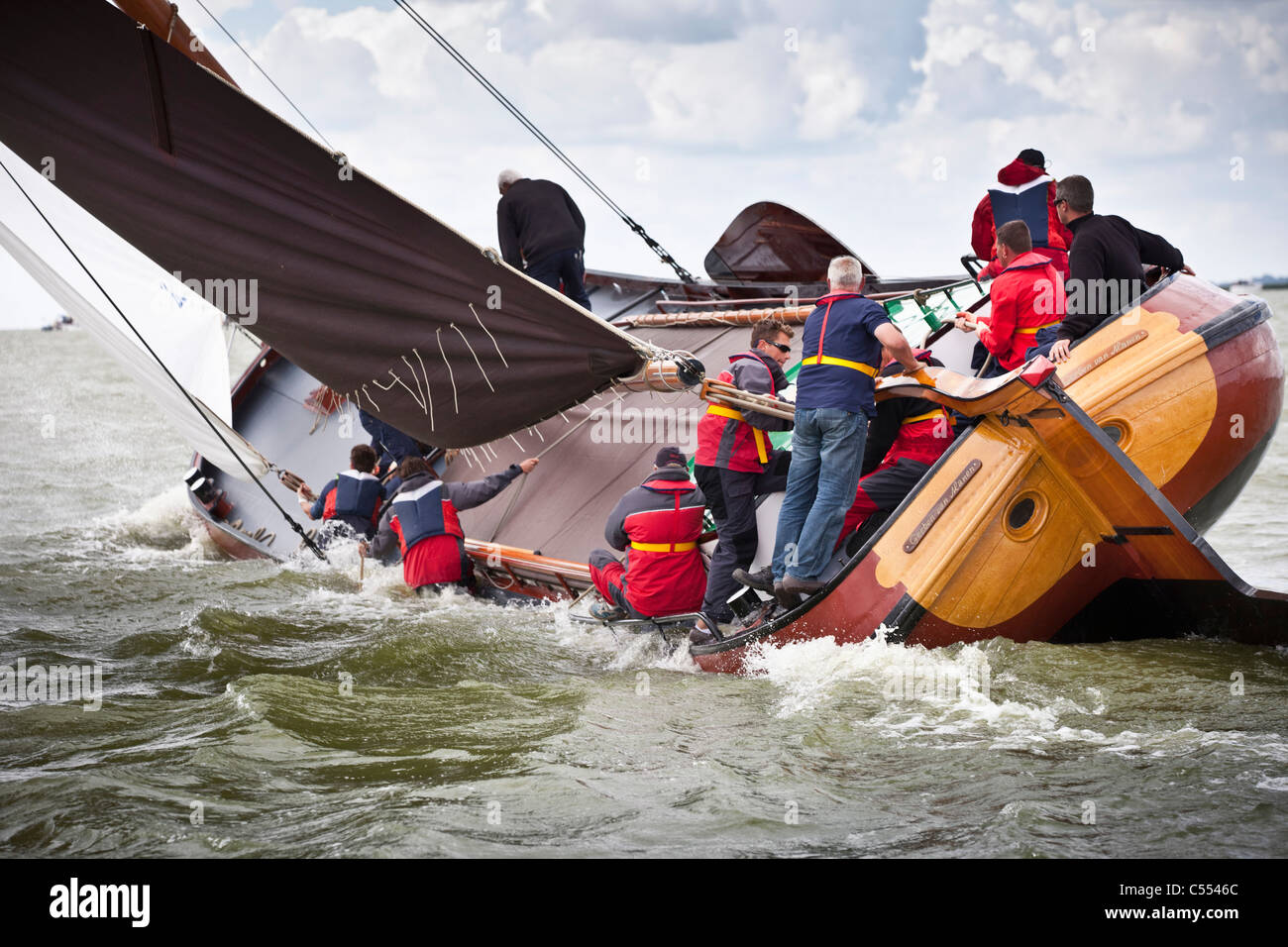 The Netherlands, Lemmer, Sailing races called Skutsjesilen, with traditional flat-bottomed cargo boats called Skutsjes. - Stock Image
