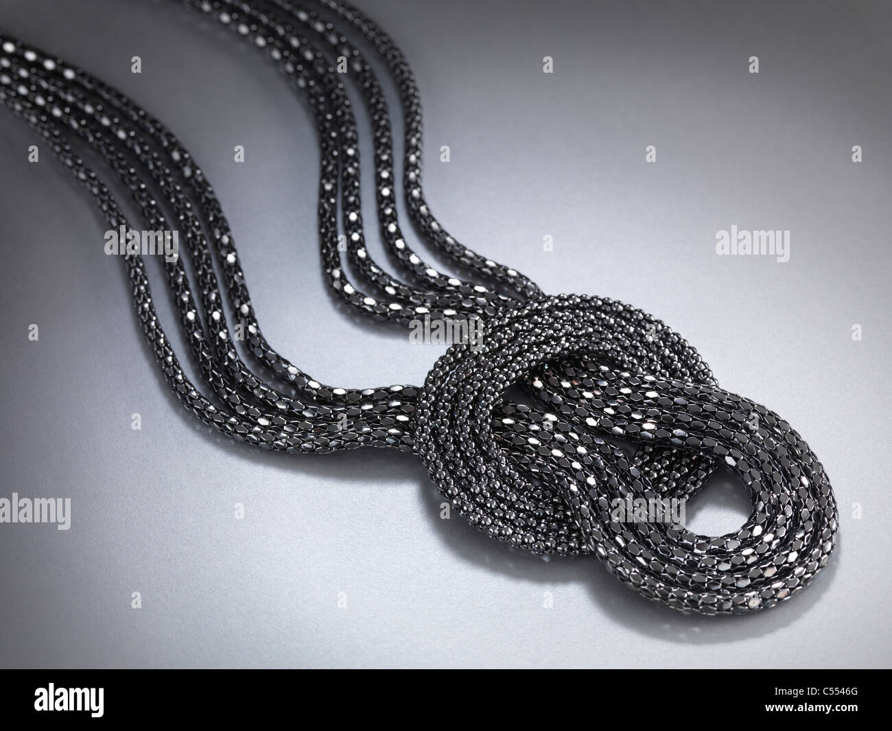 Necklace jewellery isolated on gray background - Stock Image
