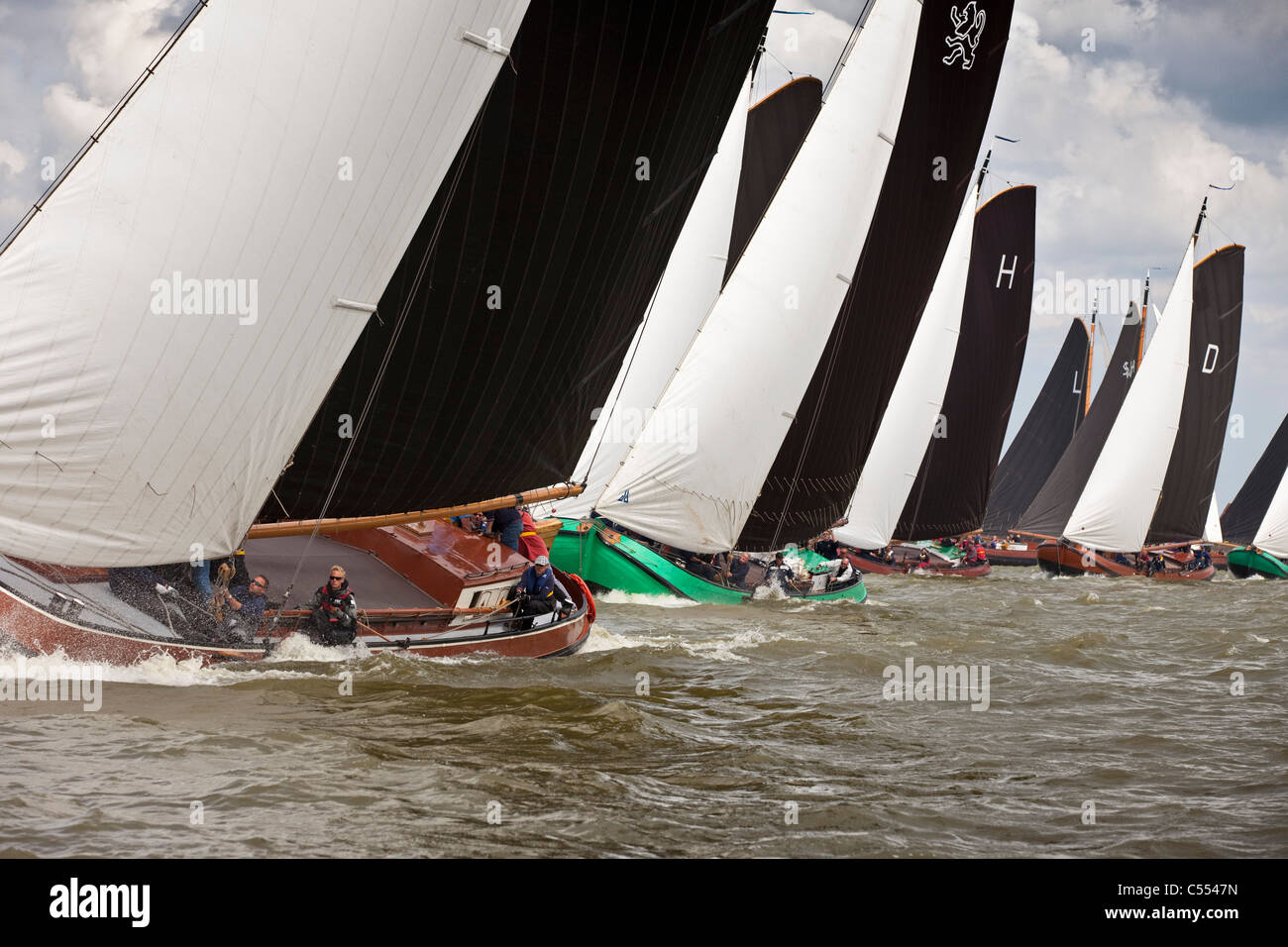The Netherlands, Lemmer, Sailing races called Skutsjesilen, with traditional flat bottomed cargo boats called Skutsjes. - Stock Image
