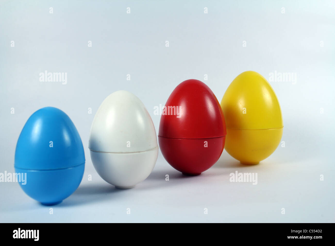 Conceptual shot of plastic eggs in different sizes - Stock Image