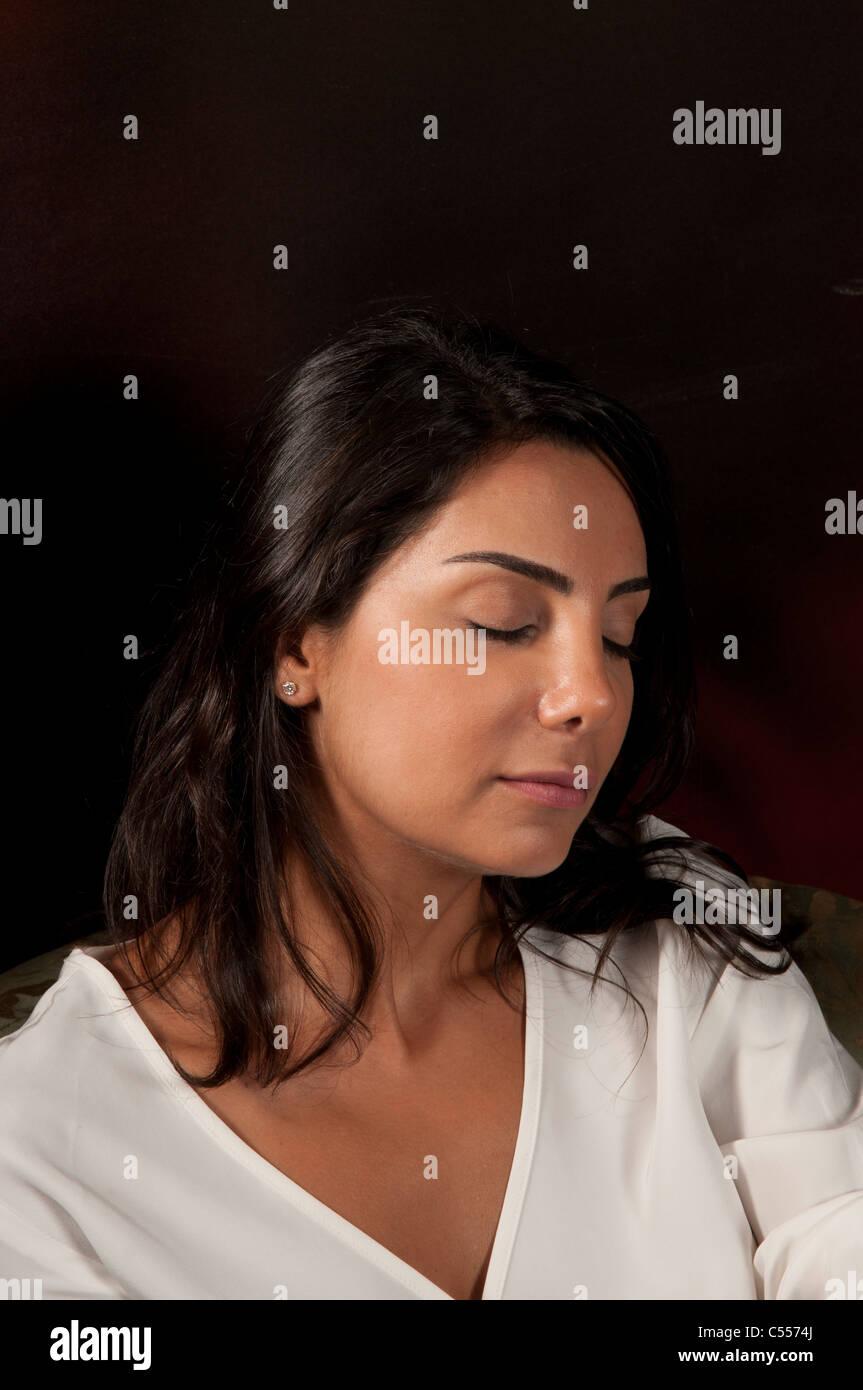 Woman eyes closed - Stock Image