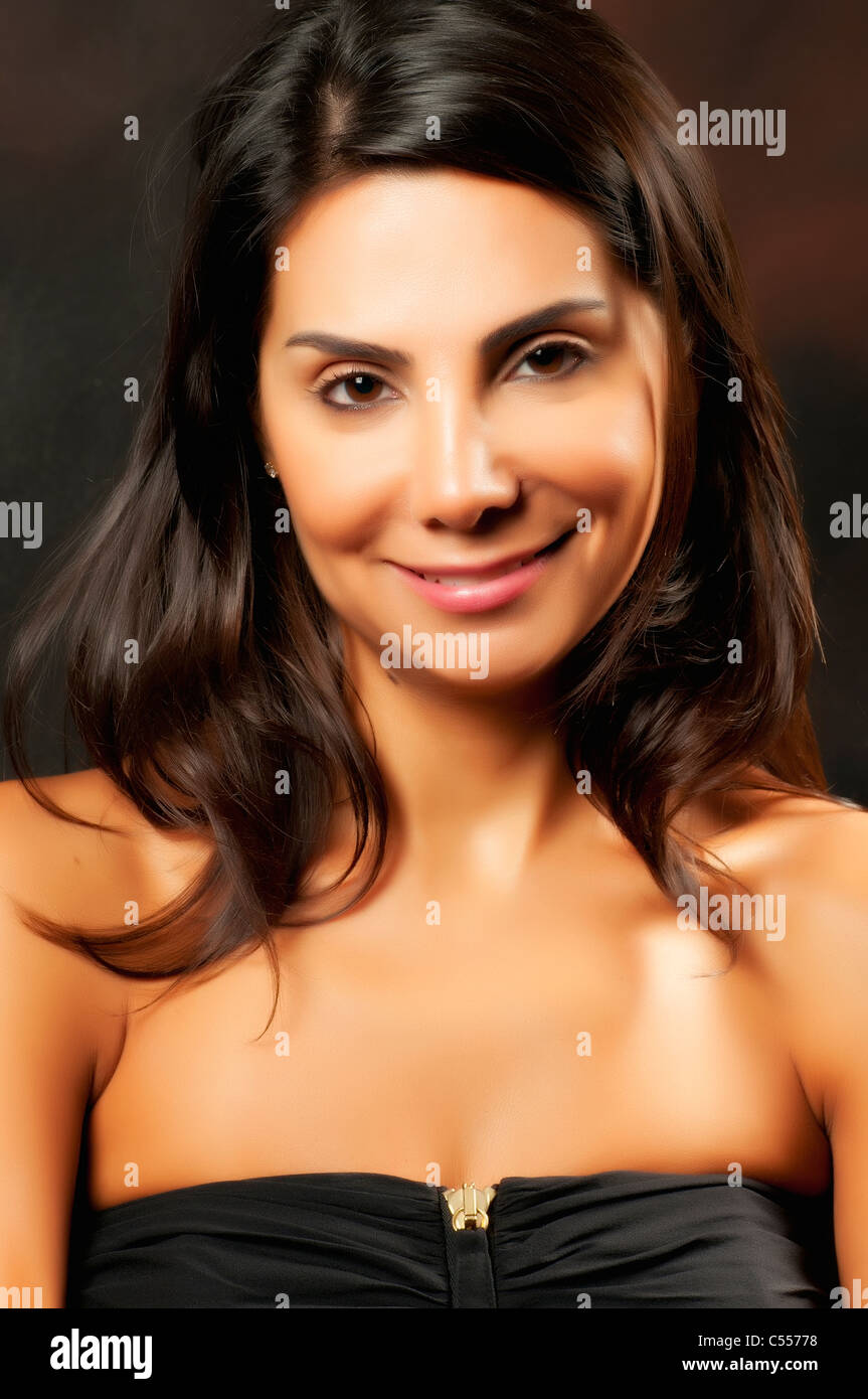 Beautiful woman smiling at the camera - Stock Image